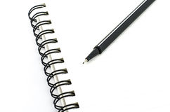 Black pen with notebook isolated on white Royalty Free Stock Photo
