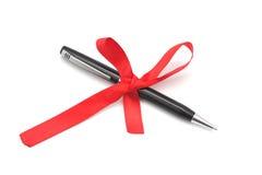 Black pen tied with a ribbon. Stock Photos