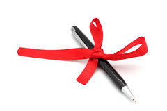 Black pen tied with a ribbon. Stock Images