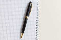 Black pen with white pad or notepad Royalty Free Stock Images