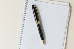 Black pen with white pad or notepad Stock Image
