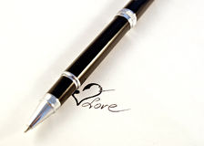 Black pen and white paper. Black  pen and paper sheet. love Royalty Free Stock Image