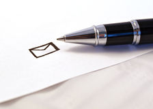 Black pen and white paper. Black  pen and paper sheet. letter Royalty Free Stock Images