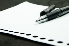 Black pen on white paper Royalty Free Stock Photography