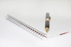 Black pen on the white paper notebook Royalty Free Stock Images