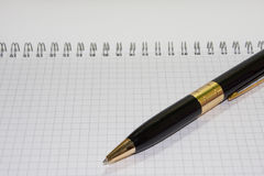 Black pen on the white paper notebook Royalty Free Stock Photography