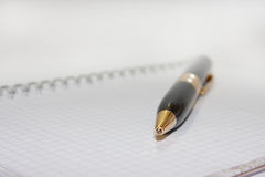 Black pen on the white paper notebook Royalty Free Stock Photos