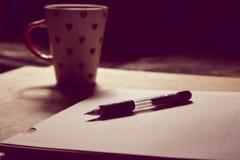 Black Pen on White Printed Paper Near White Ceramic Mug Stock Photography