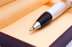Black pen in wooden box. Black pen on brown wooden box Royalty Free Stock Photo