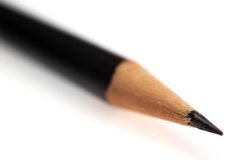 Black pencil. Isolated over a nice white background. macro photo Stock Image