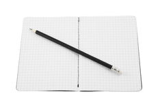 Black pencil and blank note pad Stock Images