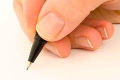 Black pencil in hand Royalty Free Stock Images