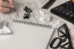 Black pencil in hand, office supplies Stock Photo