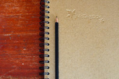 Black pencil on note book Stock Photo