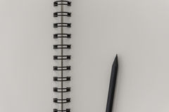 Black pencil on notebook Stock Photography