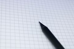 Black pencil on the notepad sheet, education concept: Image of blank notebook page with the pencil, copyspace for business. Image royalty free stock images