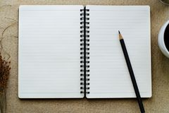 Black pencil on open white paper note book Royalty Free Stock Photos