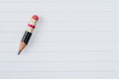 Black pencil with pink eraser on a paper Royalty Free Stock Image