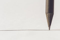 Black pencil with stroke Stock Photo