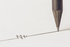 Black pencil with stroke Royalty Free Stock Photos