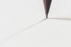 Black pencil with stroke Royalty Free Stock Photography