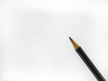 Black pencil on white background. Close up stock photo