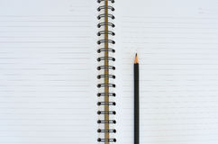Black pencil on white note book Royalty Free Stock Photos