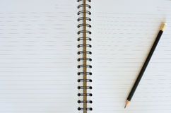 Black pencil on white note book Stock Image