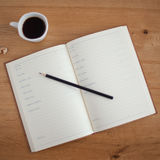 Black Pencil on White Notebook Stock Images