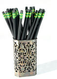 Black Pencils. In an old silver pencil/pen holder Stock Image