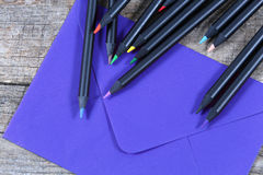 Black pencils and an envelope Stock Image