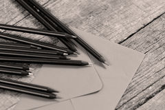 Black pencils and an envelope Royalty Free Stock Image