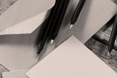 Black pencils and an envelope Royalty Free Stock Photos
