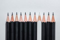 Black pencils and one another royalty free stock photo