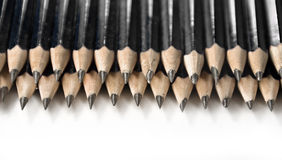 Black Pencils In Row Stock Photos