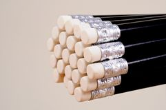 Black pencils showing erasers. Stock Photo