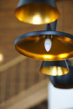 Black pendant lamp on ceiling wood wall Stock Photography