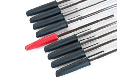 Black pens with a red one Royalty Free Stock Photos