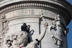 Black people on statue of Republic in Paris. Royalty Free Stock Photography