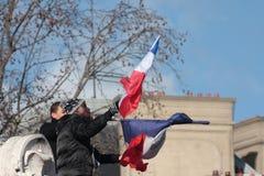 Black people waving french flag,Paris. Stock Image