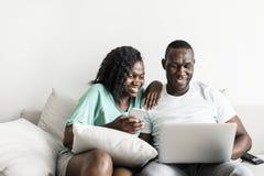 Black people working on laptop Stock Image