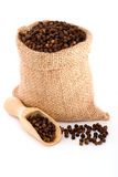 Black pepper. In burlap sack Royalty Free Stock Photography