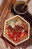 Black pepper, anise star and  bay leaf on basket Royalty Free Stock Photography
