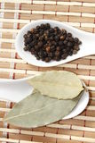 Black pepper and bay leaf Royalty Free Stock Photography