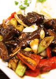 Black Pepper Beef on White Plate. On Chinese Restaurant Royalty Free Stock Photography