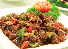 Black Pepper Beef on White Plate. On Chinese Restaurant Royalty Free Stock Image