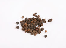 Black pepper in close-up isolated Stock Images