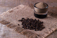 Black pepper corns and powder Royalty Free Stock Image
