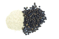 Black pepper corns scattered on white background and Black peppe Royalty Free Stock Image