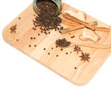 Black pepper on cutting board Royalty Free Stock Images